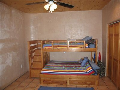Bedroom 1.  Single top bunk. Queen bottom bunk