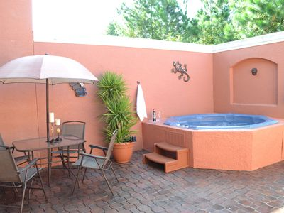 Private patio offers an 8 person hot tub
