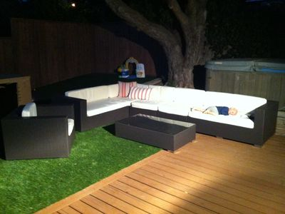 Back Yard Couch and Hot Tub