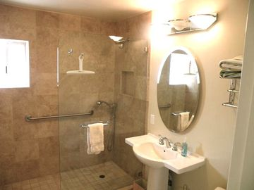 Take a hot shower in this luxury bathroom off den or use as part of Master ste.