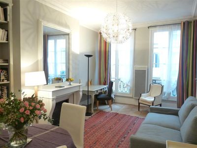 Spacious, Modern but oh-so-Parisian chic salon--parquets floors, fireplace, ceiling moldings