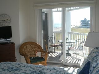 Oak Bluffs condo photo - Master Bedroom with balcony porch overlooking ocean and park.
