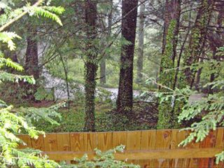 Highlands cabin photo - View from Porch with a Glimpse of Mirror Lake and the Natural Wetlands.