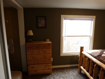 The second bedroom also has a dresser and closet
