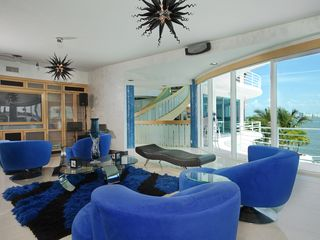 St Pete Beach house photo - Swivel chairs,very large couch,built in stereo,amazing views