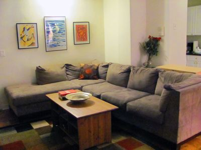 Living room furnished with L-shape Microfiber couch, coffee table, TV&DVD player