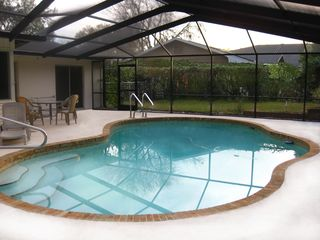 Winter Haven house photo - Private Pool with Screened Enclosure, Patio Set and BBQ