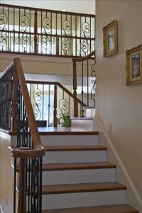 Gorgeous custom staircase from main floor living area to upper bedroom level.