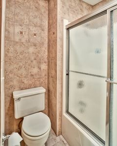 Upstairs shower room- newly renovated and tiled from floor to ceiling!