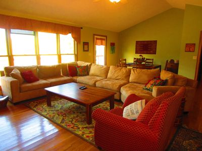 Kentucky Lake house rental - The living room, with a shot of the dining area behind it.