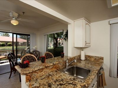 Beautiful Granite Kitchen Counters, and Breakfast Bar with New Appliances.