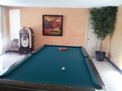 Game room pool table with new Juke-Box that plays Ipod's, Cd's, and is a radio