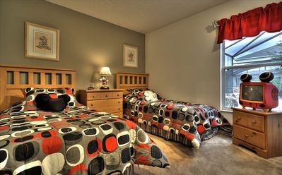 The fourth bedroom features a fun Mickey theme perfect for any age