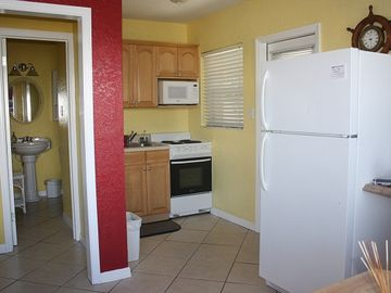 Kitchen area with all appliances and access to carport area