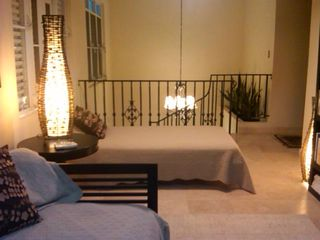 Condado house photo - Open library area with three twin size beds and the 3rd- third Plasma TV