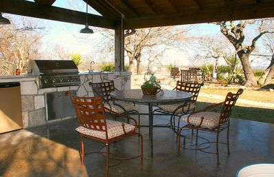 The outdoor kitchen and outdoor dining