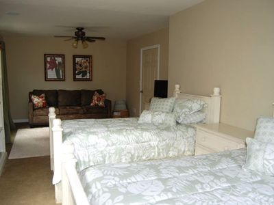 Larger downstairs bedroom with 2 twins and a pullout couch.
