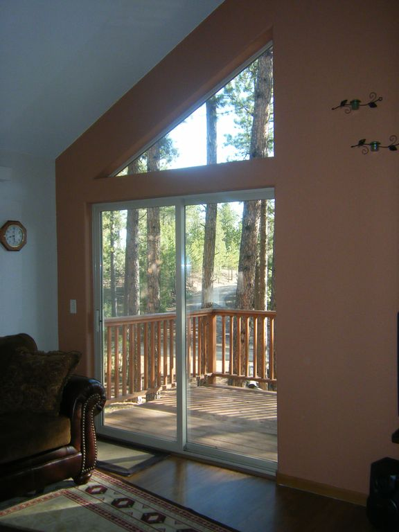 Upper level living area looking out on deck