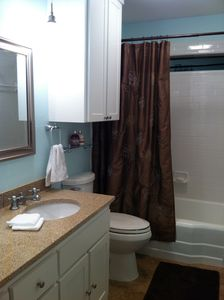 Hall bath with refinished vintage tub and granite countertop