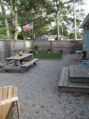 Old Glory overlooking the backyard - Buttermilk Bay cottage vacation rental photo