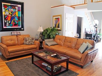 Living room has plenty of seating and large flat panel tv