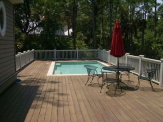 Kiawah Island house photo - Large pool and deck with outdoor seating for four.