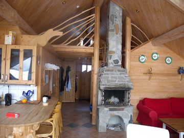Wooden cabin has a dining table & breakfast bar