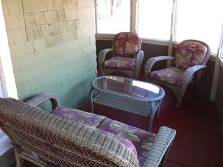 Additional seating areas on the upstairs wrap around enclosed porch - Colorado Springs house vacation rental photo