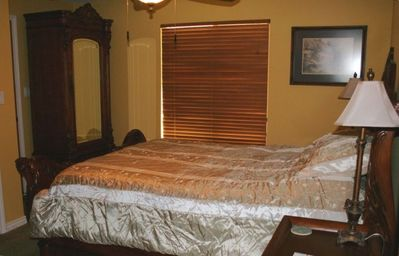 Master bedroom on main level with private bath, cable TV with DVR in armoire
