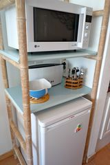 Marigot condo photo - A microwave oven, toaster and refrigerator.