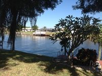 Charming 3/2 on 200' canal with dock and pool