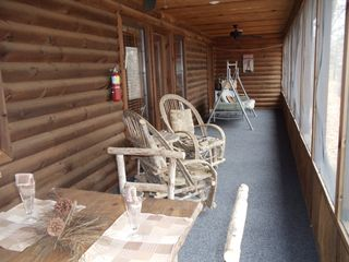 Branson cabin photo - Huge screened in back porch. Porch swing and rustic furniture.
