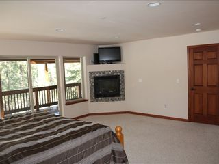 Montgomery Estates house photo - Master bedroom with 32 inch HD TV, gas fireplace