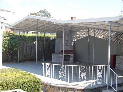 covered patio with built-in gas grill- perfect for entertaining!