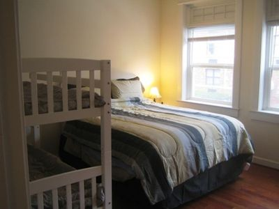 One of the two bedrooms sleeps four with queen bed and bunk bed