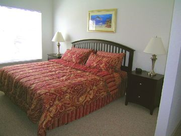 Master bedroom downstairs, king size bed & TV