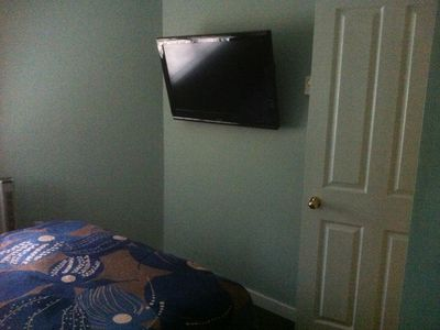Flat screen in bedroom.