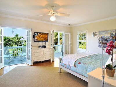 The 1st master bedroom: French doors, high-def TV & overhead fan.