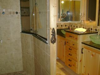 Walker cabin photo - Master bath with shower and double sinks.