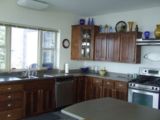 Cutler house photo - Kitchen- Custom cherry cabinets, stainless appliances, tile floors, ocean views