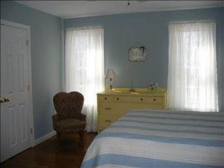 Eastham house photo - The main level Bedroom is very inviting Full Bed with hardwood floors and wonderful bedding.