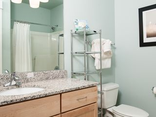 Lincoln City condo photo - Two Luxurious Bathrooms With Granite Counters and Tile Floors