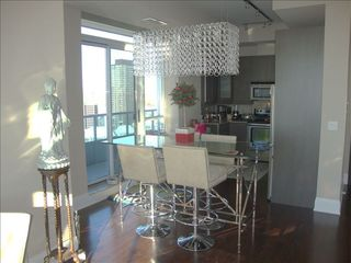 Toronto condo photo - Dining with Belgium hand blown chandelier