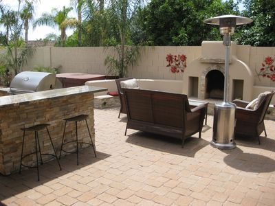 backyard patio with outdoor fireplace, BBQ, spa and pool
