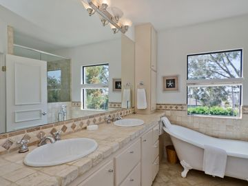 Master bath with his and hers sinks, and separate shower and bathtub.