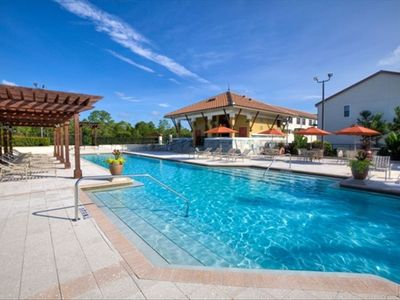 Luxurious Pool with Chairs Tables and Umbrellas with Lanai Shaded Areas