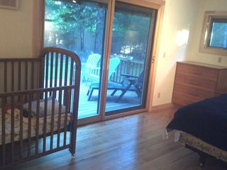 Woodstock cabin photo - Main bedroom facing deck with crib and full-sized bed