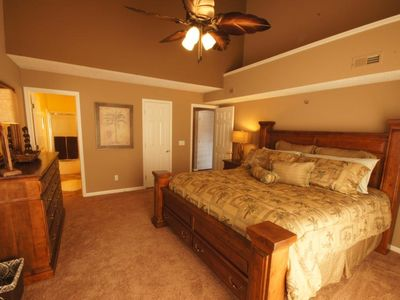 The Master Suite offers a King Bed, TV w/ DVD, Ceiling Fan, and Door to Deck