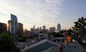 View of Cincinnati's skyline from the Roof Deck ~ restaurants in foreground.