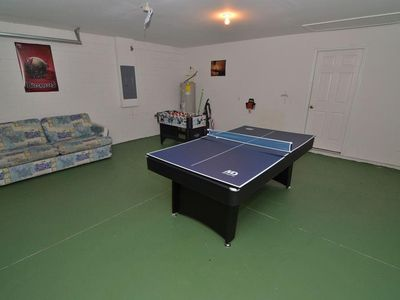 The games room set up for table tennis / ping pong!